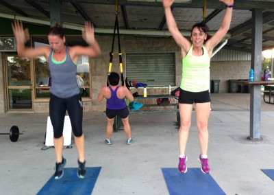 Leanne and Cherie keep their burpees in sync.