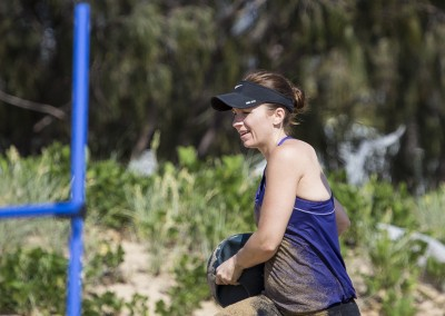 Haley Bilston completes walking med-ball lunges during a beach workout.