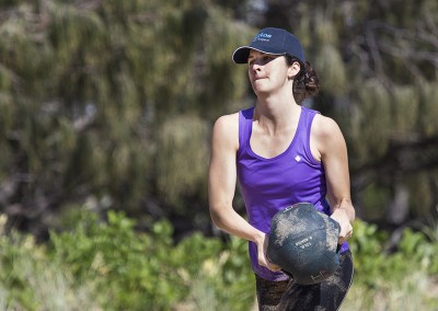 Lucinda completes med-ball walking lunges during a beach workout.
