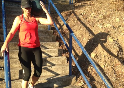 Jo completes a weighted stair carry.