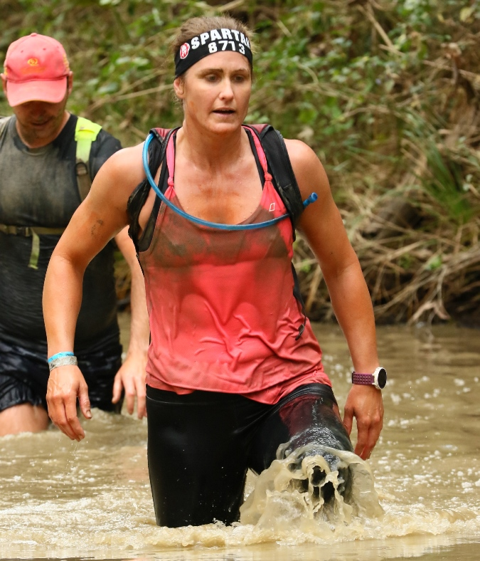 Into the wild: a deep water wade tested Spartans at last week's obstacle race in Brisbane